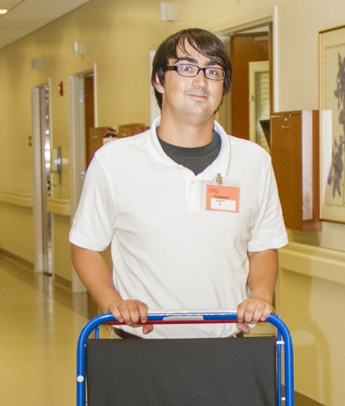 Scott Kremmel is among the more than 50 high school and college students from throughout the St. Louis area who are providing service this summer to departments throughout St. Anthony's Medical Center.