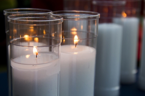 Lit candles at St. Anthony's at de Greeff Hospice House walk