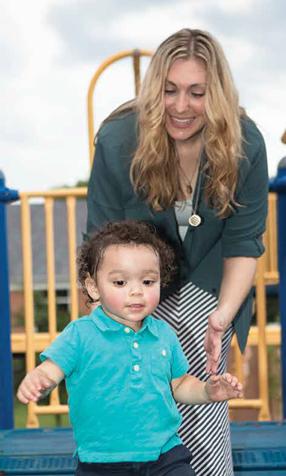 Julianna Becton plays with son Ari.
