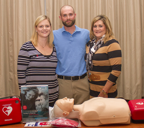 Brett Arb with his wife, Trina, and mother, Cindy, at St. Anthony's AED distribution reception.
