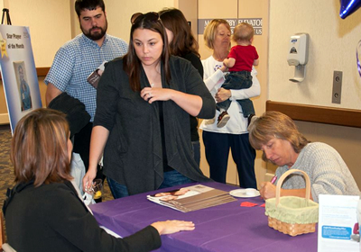 Participants register at the 2014 St. Anthony's Baby Fair